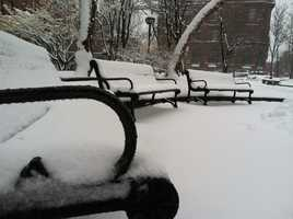 Snow covered benches in Portland