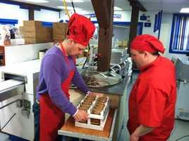 News 8's Norm Karkos helps make chocolate bunnies.