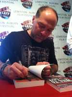 Stroud signed copies of his books Thursday at the film festival's kick off event