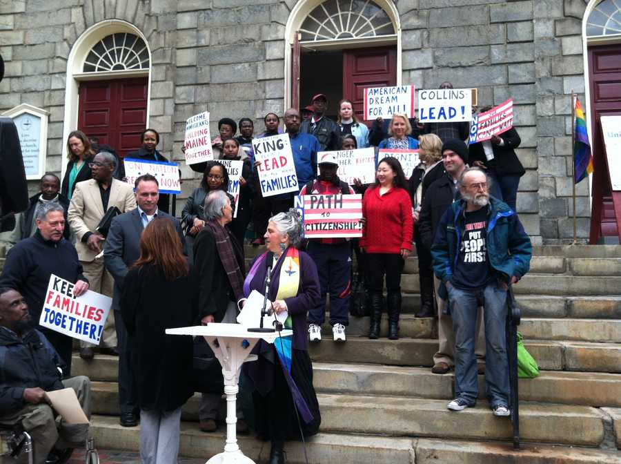 A rally was held Wednesday morning in Portland urging Sens. Collins and King to support immigration reform.