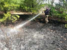 Crews battled a brush fire Monday morning in Old Orchard Beach.