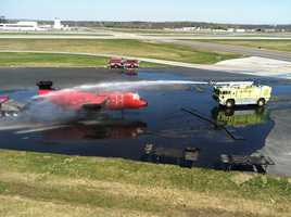 Firefighters in Portland trained on how to respond to a fire in a plane at the Portland International Jetport on Tuesday.