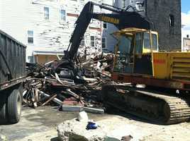 Crews demolished 116 Pierce St., in Lewiston on Monday. The building was destroyed in the May 3 fire that left 104 people homeless.