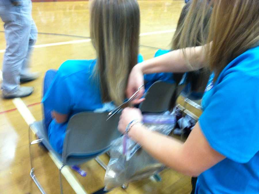 Dozens of students, teachers and other volunteers at Greely High School in Cumberland chopped off their hair for a good cause.