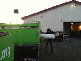 It is just after sunrise when the Garbage to Garden crew loads up its custom bucket truck and readies to hit the road.