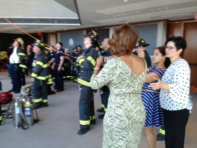 Gayle King, in the green dress, was one of several Hearst employees who came up to the 44th floor to witness the rescue.