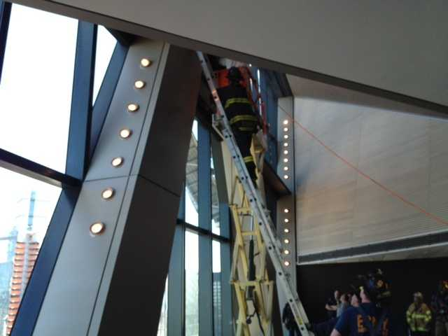The two men were rescued shortly after 4 p.m. and brought into the Hearst Tower through the hole that was cut.