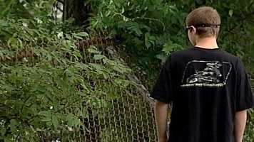Standing about waist deep, Andrew finally spotted the boy motionless next to a tree, his lips were blue, he said.