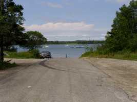 This a look at the road in the daylight that leads to the boat ramp where the women were killed.