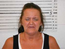 Julie A Davis is charged with attempting to acquire drugs by deception and forgery.