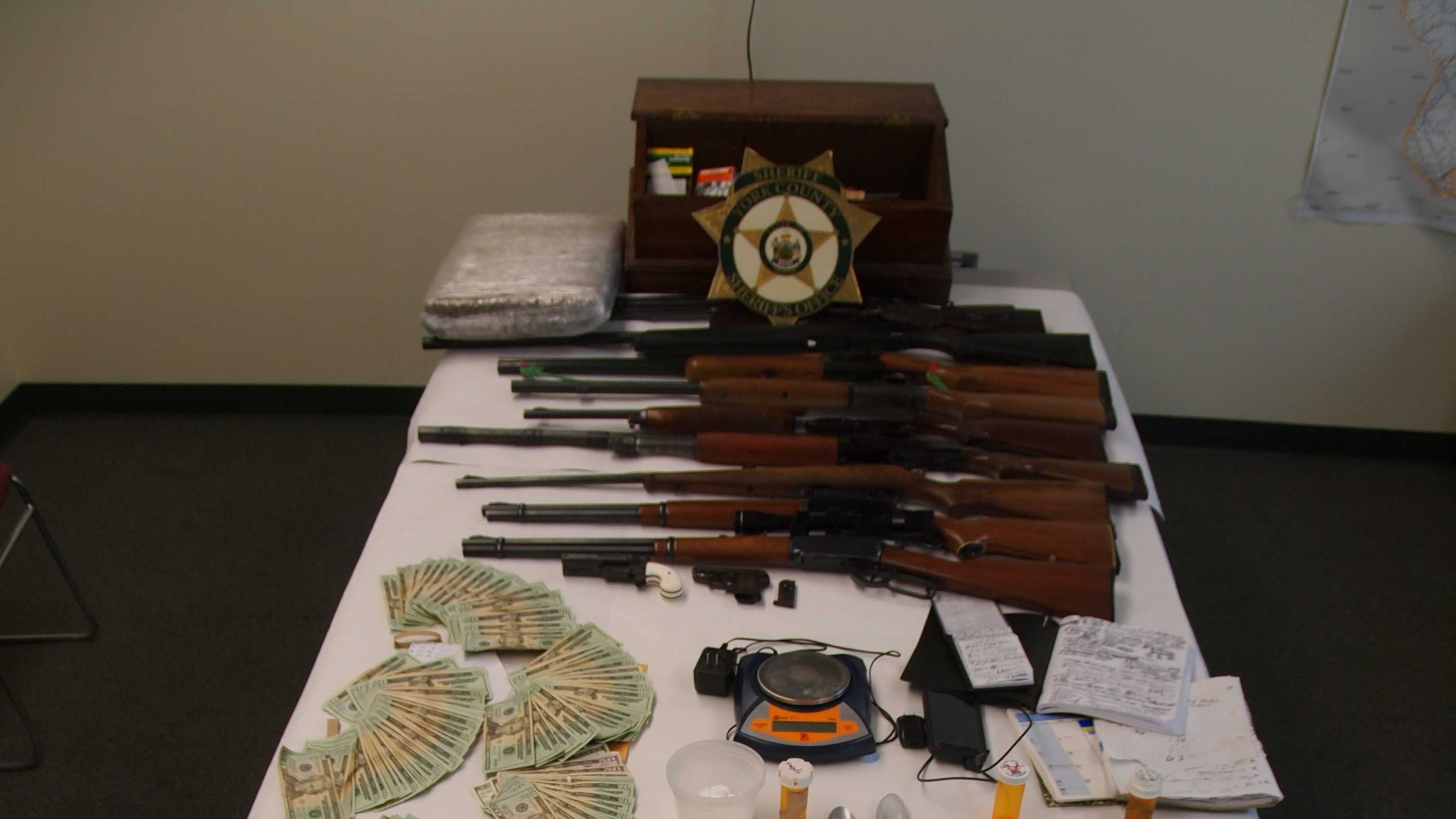 Siezed drugs, money, and guns.jpg