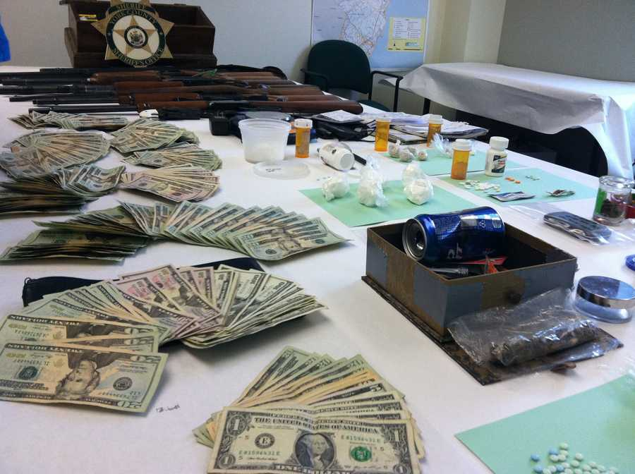 They also seized 12 rifles, two handguns, various drug paraphernalia and approximately $10,000 cash in suspected drug proceeds.