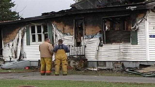 Police have charged a Houlton man with the murders of two people whose bodies were found in a burned out home in Oakfield on Monday.
