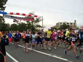 Hundreds of runners leave the start line in Portland to begin the 22nd Maine Marathon on Sunday. Construction on Martin's Point Bridge forced organizers to develop a new course that took runners from Portland to Yarmouth and back.