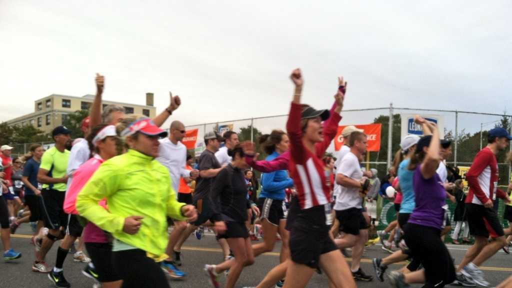 Runners celebrate as they begin the 22nd Maine Marathon in Portland.