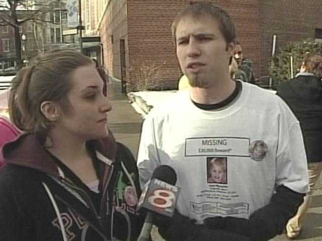 January 28, 2012: Trista Reynolds and Justin Dipietro embrace at vigil. Police confirm blood found in basement of 29 Violette Ave during search