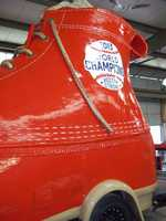 L.L. Bean said it has also colored its Bootmobile red for Saturday's parade in Boston.
