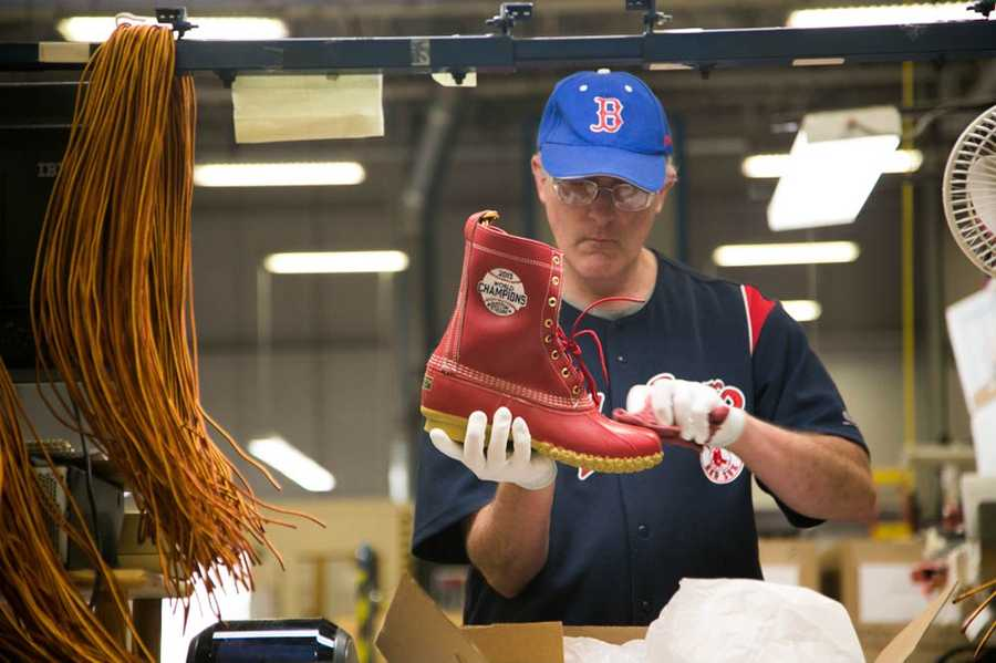 The boots are red with a commemorative logo. The boots are custom fitted for each member of the team and staff.