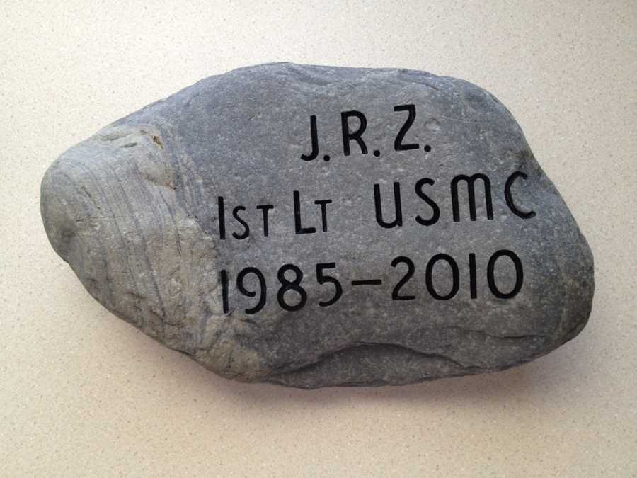 To honor 1stLt James R. Zimmerman, his parents, Mr. Tom Zimmerman and Mrs. Jane Zimmerman retrieved this stone from an outdoor fire pit near the lake on their property in Smyrna, Maine. Click here to learn more about 1st Lt. Zimmerman.