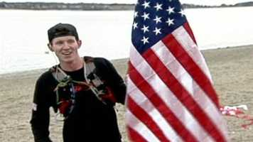 Ret. Marine Sgt. Brendan O'Toole finished a cross country run that covered 3,600 miles and 21 states at Portland's East End Beach with an escort of supporters.