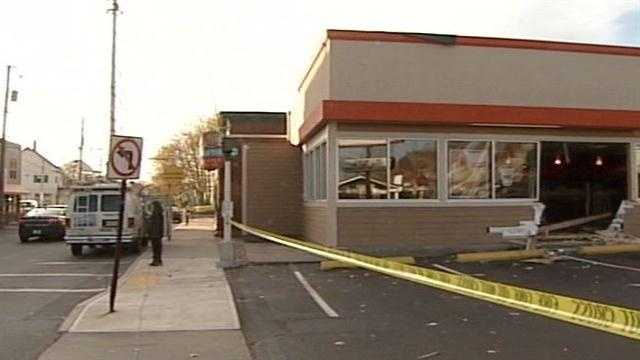 Portland police said a vehicle crashed through the front of a Dunkin' Donuts restaurant Thursday morning.