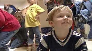 A 6-year-old boy in Sabattus is spreading holiday cheer and helping his classmates.