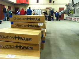 Firefighters in Lewiston donated dozens of coats to local kids Tuesday morning as part of Operation Warm.