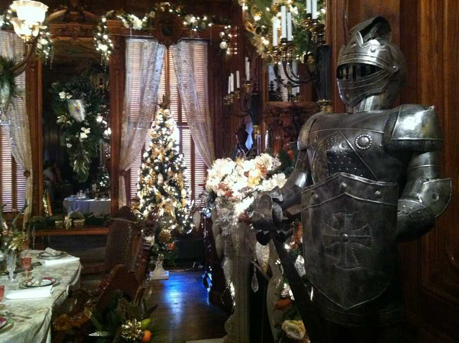 A suit of armor stands inside one of the many beautifully decorated rooms inside the Victoria Mansion in Portland.