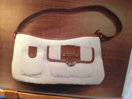 Investigators said the girl may have had this handbag in her possession.