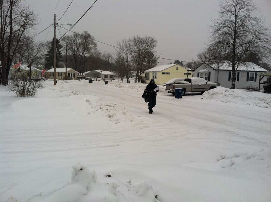 Postal workers bundle up to stay warm during the storm