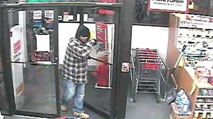 The suspect depicted in this surveillance picture from the Jan. 17 robbery at CVS on Forest Avenue is described as a black man, about 6' tall in his 30s or 40s.
