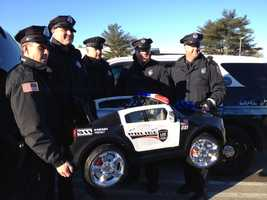 Tyler's mother, Rachel Seddon-Dunn, put out an appeal on social media asking first responders to send birthday messages to her son.  Woburn police officers gather at the Burlington Mall with a miniature police car for Tyler Seddon's birthday.