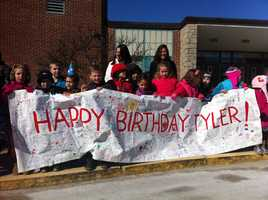 Classmates greet Tyler at his school.