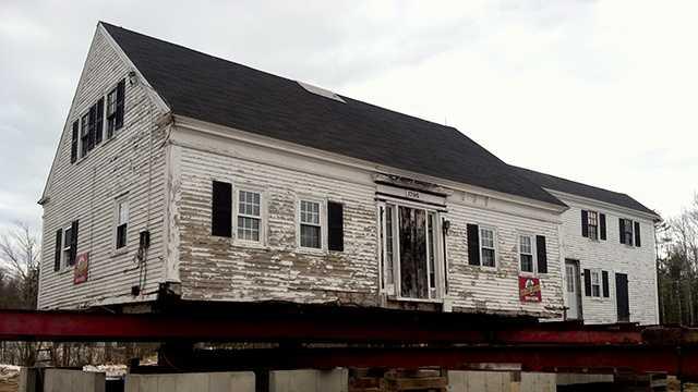 Historic Arundel farmhouse moved onto new foundation