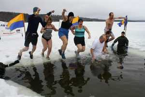 The first Ice Out Plunge for Special Olympics Maine raised $18,000 over the weekend.