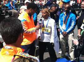 Male winner Meb Keflezighi talking with media