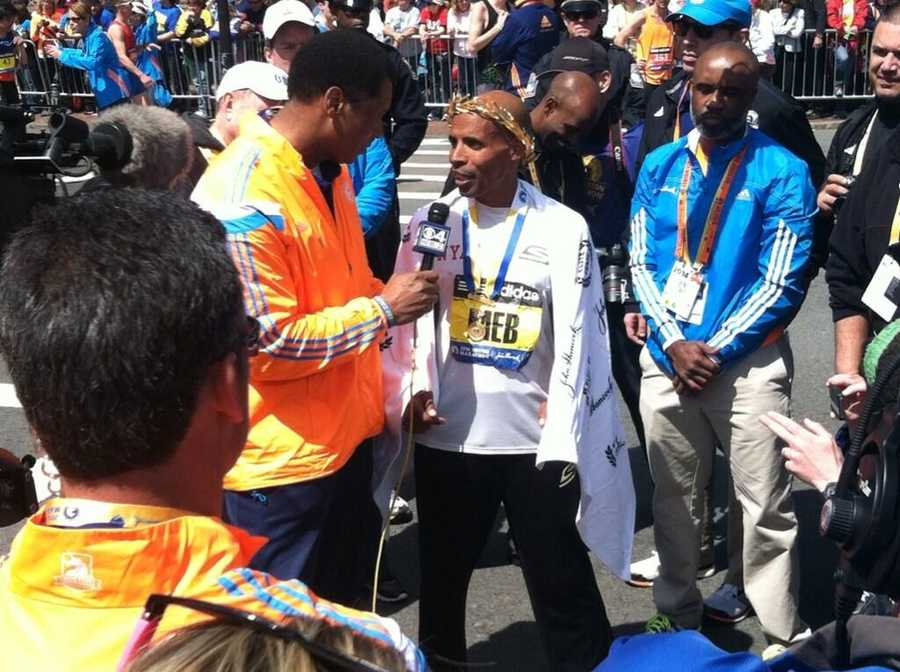 Male winner Meb Keflezighi talking with media