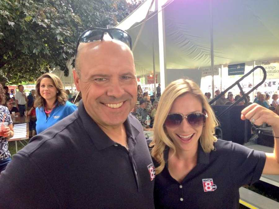 WMTW's Norm Karkos and Katie Thompson brought the muscle in this year's Shucking Contest at the 2014 Clam Festival