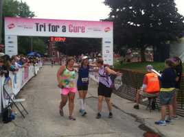 Competitors celebrate at the Tri for a Cure finish line on Sunday morning.