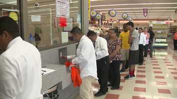 Part-time workers are notified there is no work for them after August 9.  They line up at the Chelsea Market Basket to get what could be their final checks on August 7, 2014.
