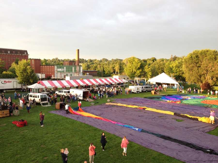 Balloonists prepare for the first launch of the 2014 Great Falls Balloon Festival