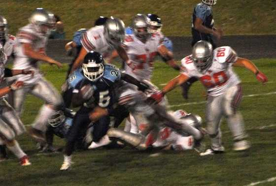 Check out a high school football game on Friday night.