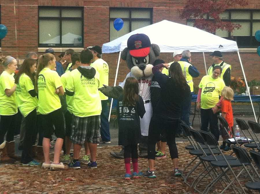 Slugger the Sea Dog greets participants of the Easy as Pi Road Race