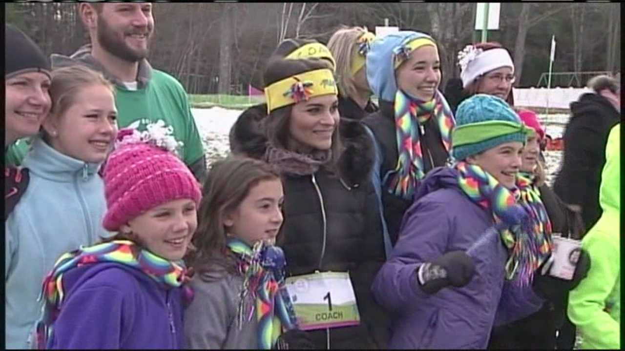 Dozens of young girls in grades three through five laced up their sneakers Sunday to celebrate the Girls on the Run program's annual 5K. The run is held on the trails of Pineland Farms in New Gloucester.