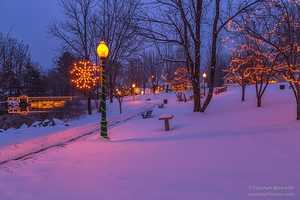 Blue hour in Bridgton brought brightly lit snowflakes, colorfully wrapped lamp posts and freshly fallen snow.