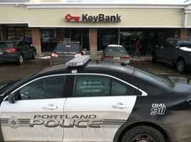 Police said the Key Bank on Auburn Street was robbed at 11:20 a.m. Click through to see surveillance pictures of the robbers.