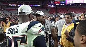 Chandler Jones and Brandon Browner celebrate postgame.