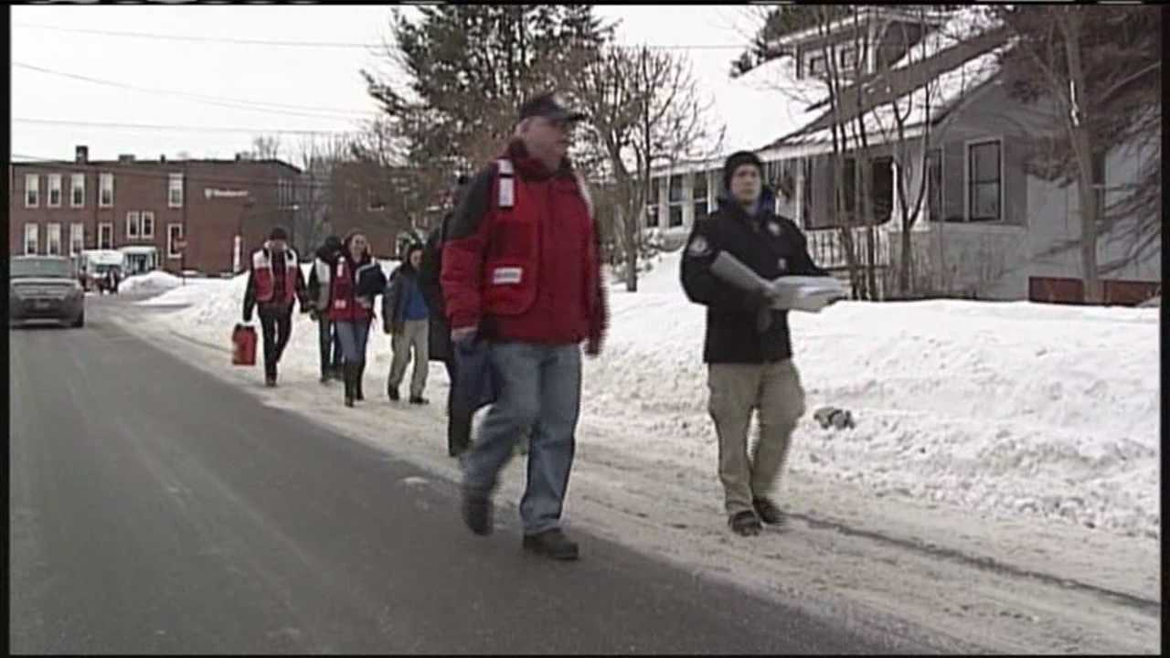 Red Cross volunteers handed out smoke and carbon-monoxide detectors Sunday.