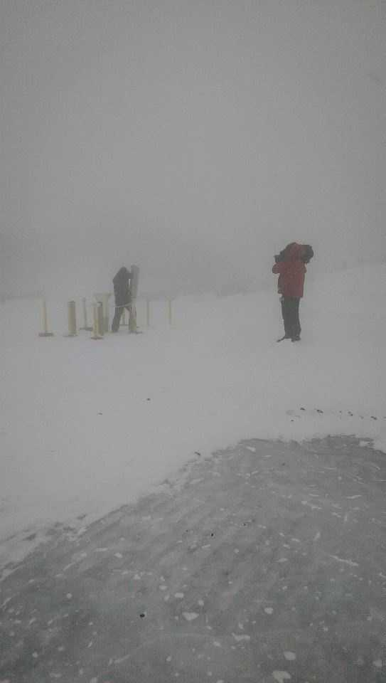 "The location of the ""precip can"" is in the center of the parking area near the actual summit of Mt. Washington. It's the farthest point Observers have to travel from the building during a weather observation. The fog, snow, blowing snow can all be disorienting."