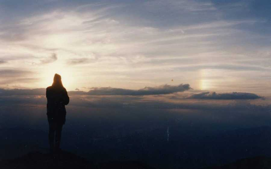 Sun dog from the summit. Someone snapped this shot of me taking it all in. This was the summer that I interned, no wonder I returned.